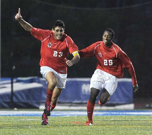 Friends Academy's Jonathan Nierenberg, left, celebrates his game-winning