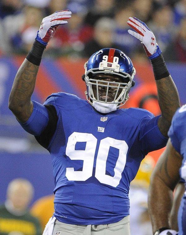 Giants defensive end Jason Pierre-Paul raises his arms