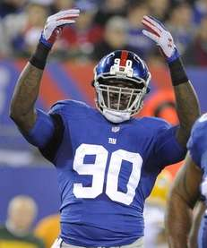 Giants defensive end Jason Pierre-Paul raises his arms
