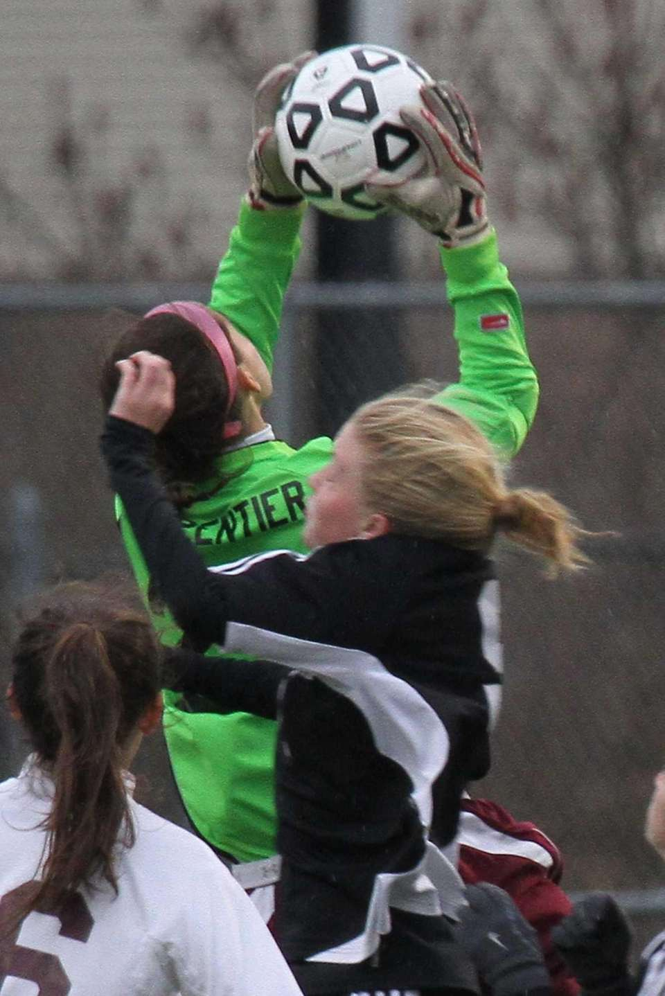Garden City's Taylor Carpentier goes high for the