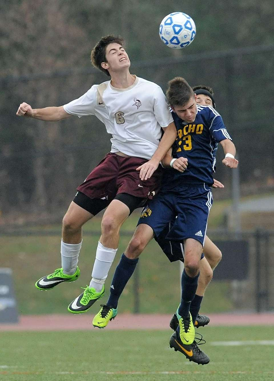 Jericho's Jon Amodio, right, challenges for a header