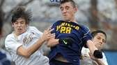 Jericho's David Greenbaum, center wins a header over
