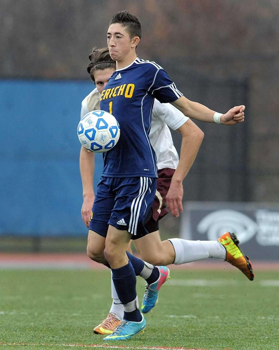 Jericho's Drew Shuman settles the ball to his