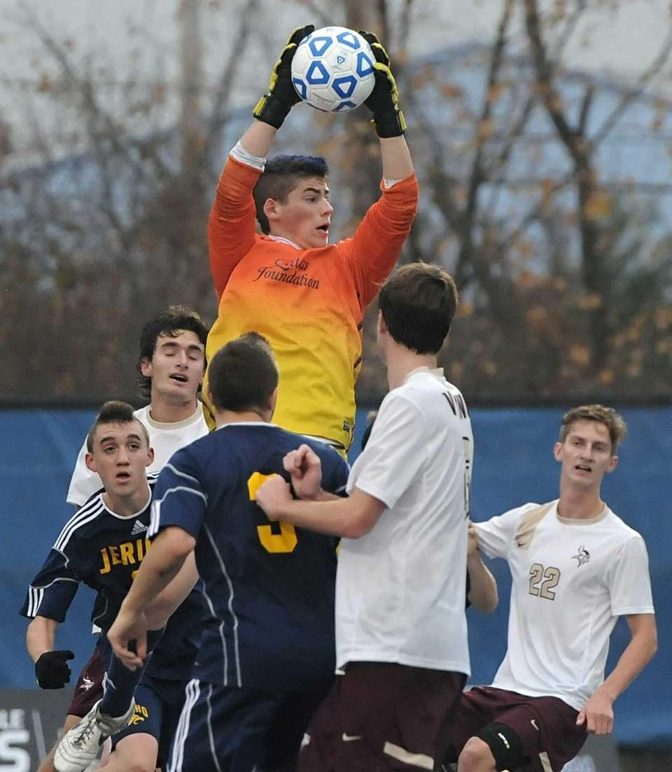 Jericho goalkeeper Reed Ginsburg reaches above the crowd