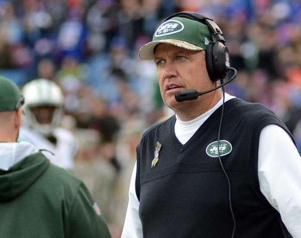 Jets head coach Rex Ryan walks on the