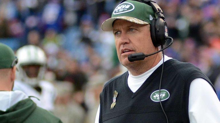 Jets head coach Rex Ryan walks on the