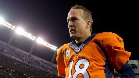 Denver Broncos quarterback Peyton Manning runs off the