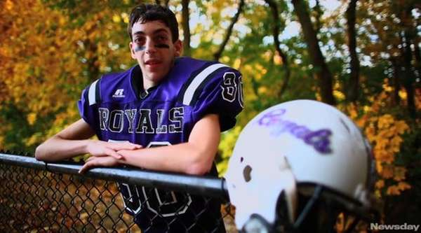 As a young boy, Naji Nizam fell in love with football. Playing was all he ever wanted, and he wouldn't let anything stand in his way, not even the debilitating disease that should have made the Port Jefferson boy's goal impossible. Videojournalist: Chris Ware (Nov. 14, 2013)