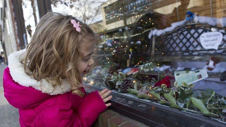 Olivia Sulzer, 3, from Aquebogue looks at one