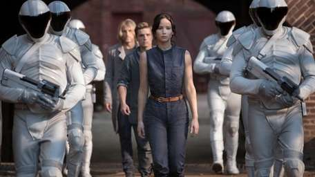 Jennifer Lawrence as Katniss Everdeen, from foreground to