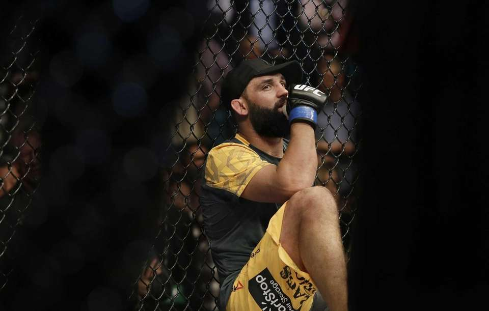 Johny Hendricks listens as Georges St. Pierre, of