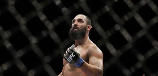 Johny Hendricks walks to his corner during a