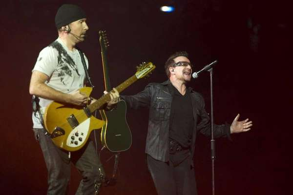 Bono, right, and The Edge perform in concert