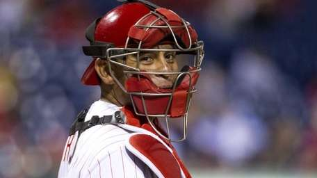 Philadelphia Phillies catcher Carlos Ruiz looks back to