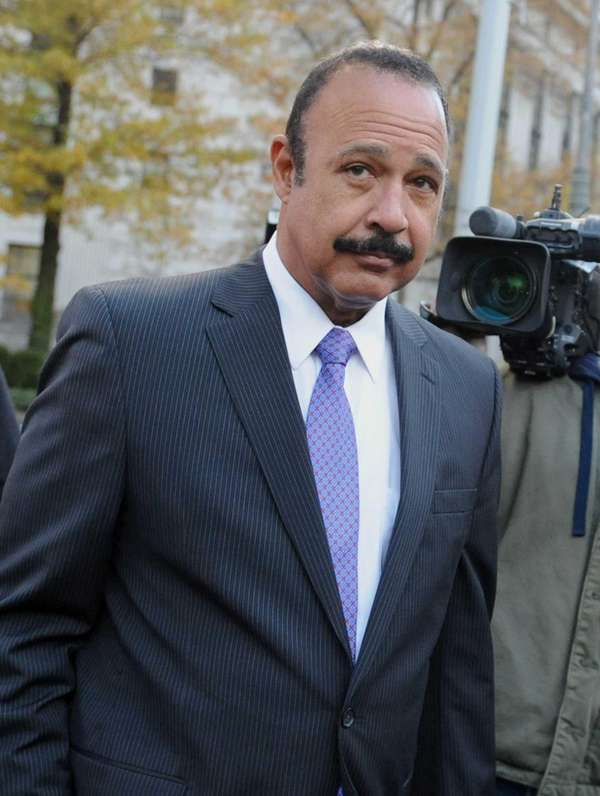 Attorney Ted Wells exits federal court in New