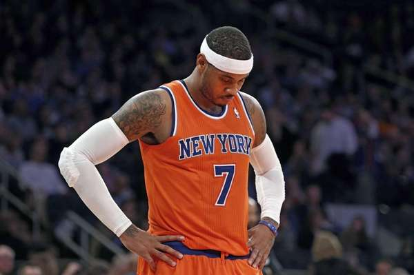 Carmelo Anthony waits during a break late in