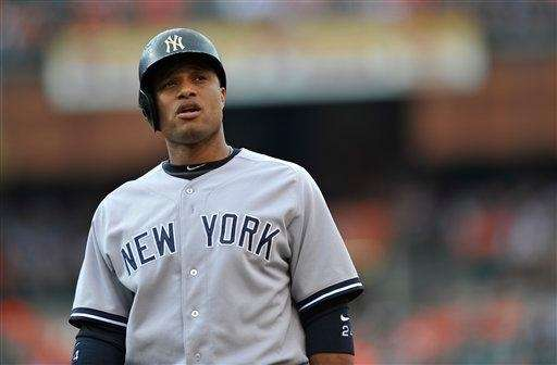 Robinson Cano stands on the field between innings