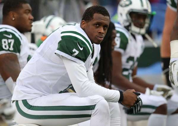 Geno Smith looks on from the bench after