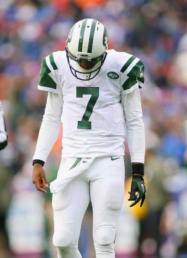 Geno Smith reacts after throwing his third interception