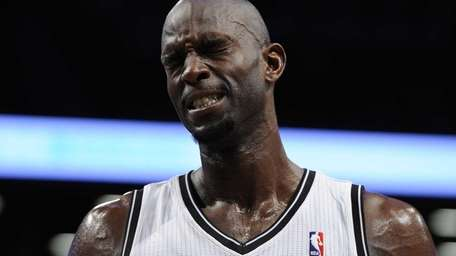 Kevin Garnett reacts on the court during a