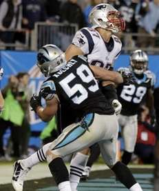 Carolina Panthers' Luke Kuechly blocks New England Patriots'