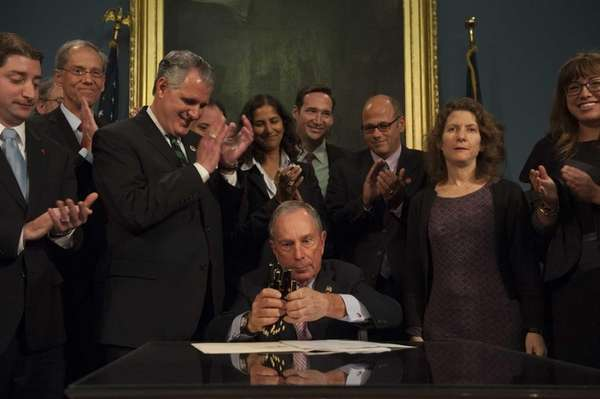 New York City Mayor Michael Bloomberg, seated, is
