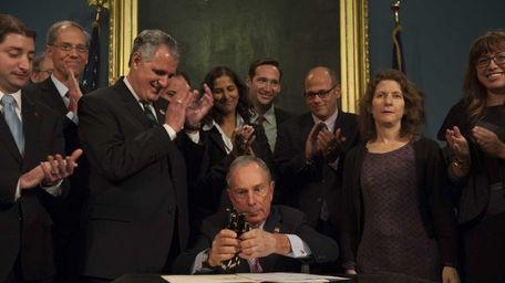 New York City Mayor Michael Bloomberg, seated, is