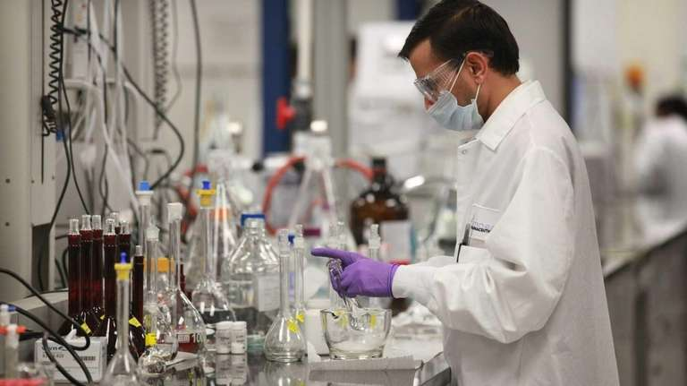 Lab technicians work at Amneal Pharmaceuticals' South Yaphank