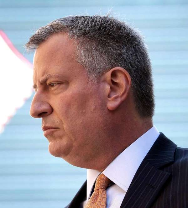 New York City mayor-elect Bill de Blasio attends