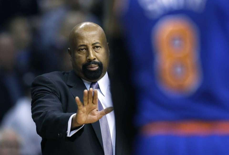 Knicks head coach Mike Woodson looks towards guard