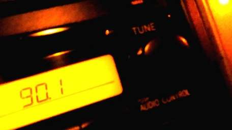 A car stereo tuned to 90.1 WUSB-FM. The