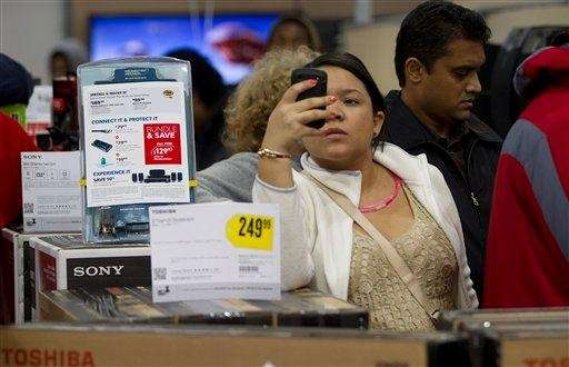 A shopper uses her smart phone to shop
