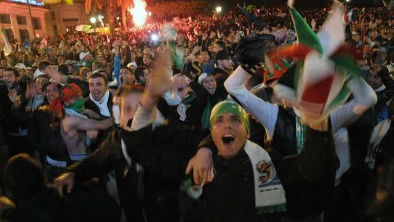 Algerians celebrate their victory after the World Cup