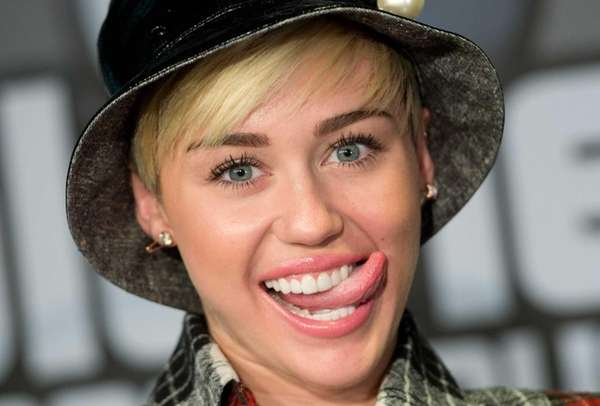 Miley Cyrus posing during a press conference at