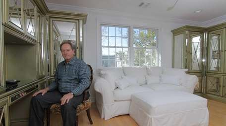 John Melillo in an office at his home