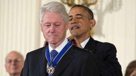 President Barack Obama awards former President Bill Clinton