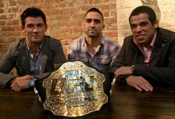 Reigning UFC MMA bantamweight champion Dominick Cruz, left,