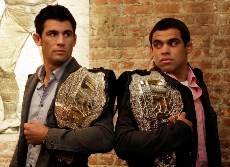 Reigning UFC MMA bantamweight champion Dominick Cruz, left,
