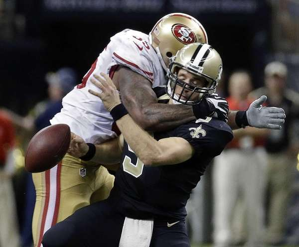 New Orleans Saints quarterback Drew Brees is sacked