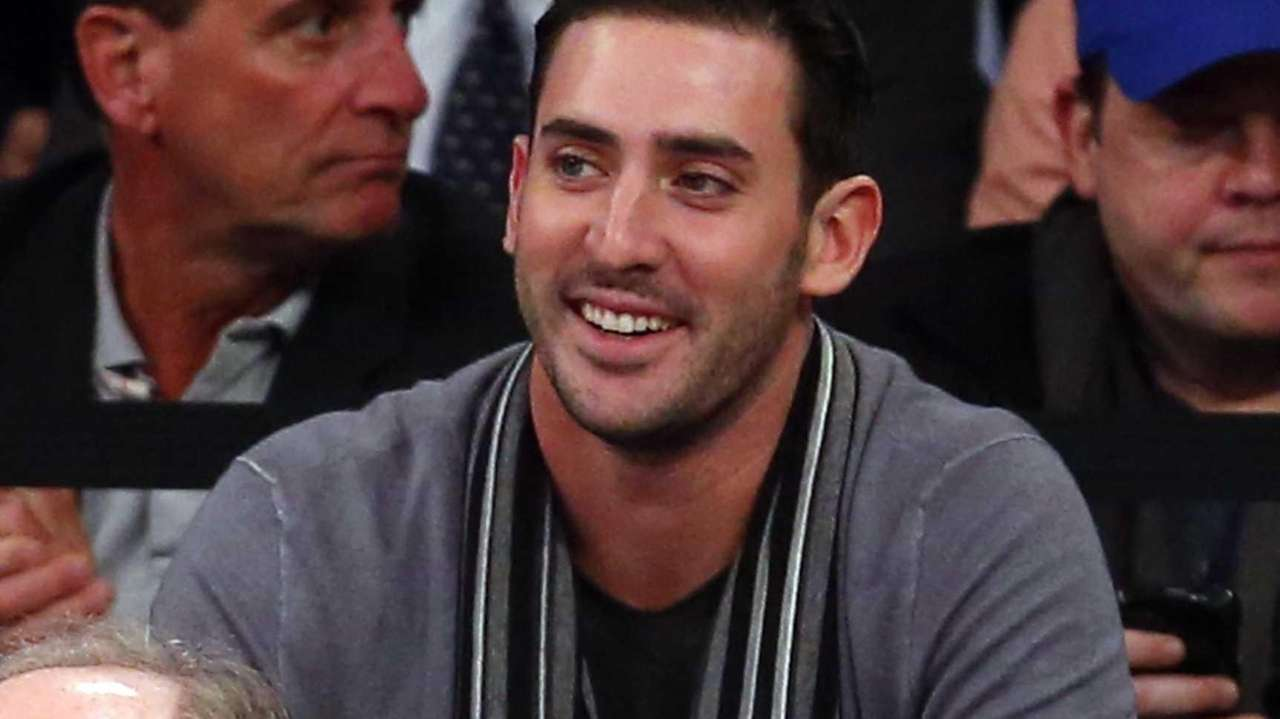 Matt Harvey of the Mets attends the game