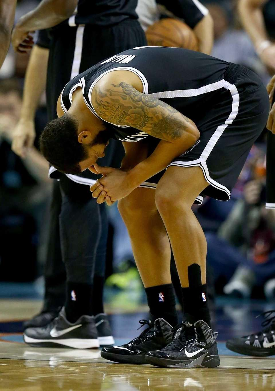 Deron Williams reacts after an injury in the