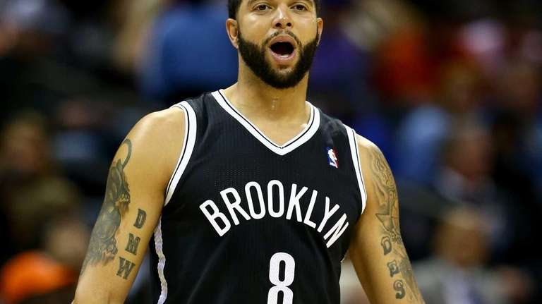 Deron Williams yells to a teammate during a