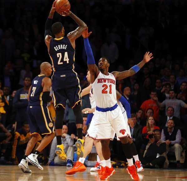 Iman Shumpert of the Knicks commits a foul