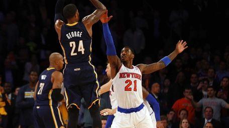 Iman Shumpert of the Knicks commits a foul