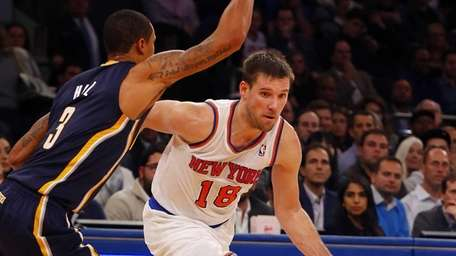 Beno Udrih of the Knicks controls the ball