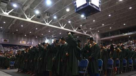 After receiving ceremonial diplomas onstage, the 318 members