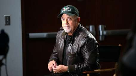 Recording artist Billy Joel attends a news conference