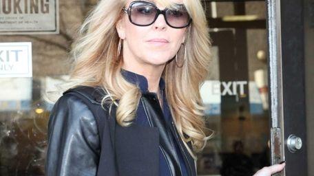 Dina Lohan leaves court in Hempstead Thursday. Lohan