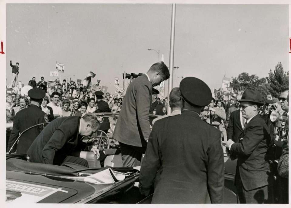 Sen. John F. Kennedy gets out of his