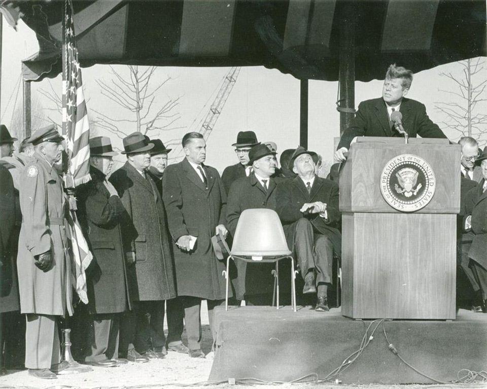 The wind tosses President John F. Kennedy's hair